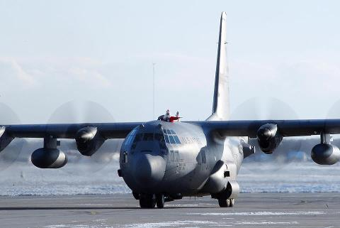 Guns and Military Airmen from the 107th Airlift Wing give Santa a ride on a C-130 Hercules during Operation Toy Drop, Dec. 12, 2011, at Niagra Falls Air Reserve Station, Niagra Falls, N.Y. Operation Toy Drop is a week-long project where both American and foreign paratroope
