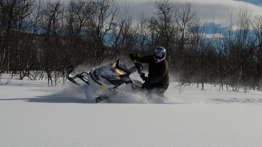 Snowmobile deep fluffy powder sledding