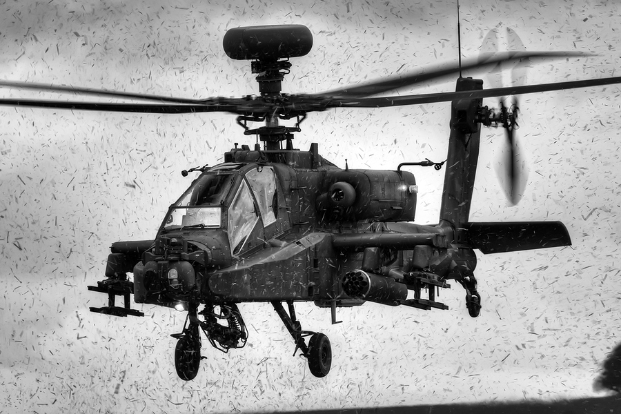 Guns and Military Getting showered in mud, grass & god knows what else as this Army Air Corps apache departs. Think the sensor needed a clean after this!