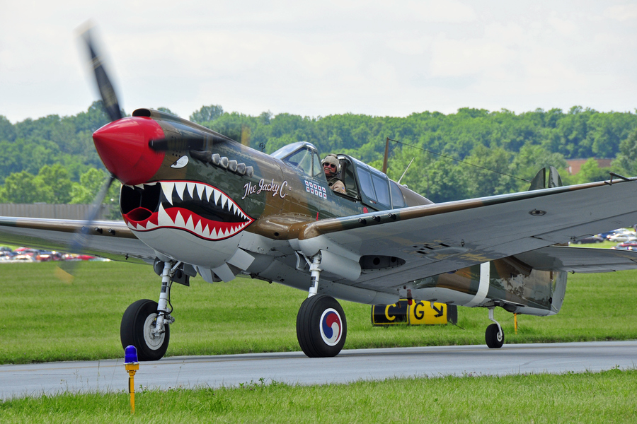 Guns and Military A Curtiss P-40 Warhawk taxis for departure at the 2012 Reading Air Show in Reading, Pennsylvania