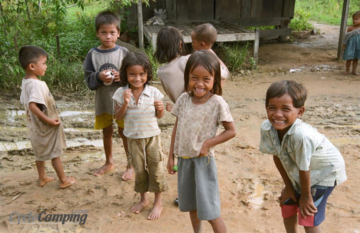 Entertainment I was going through our pictures for an upcoming slideshow presentation we will do at the Philly Bike Expo and I found this picture. When I saw those smiles, I instantly forgot about the horrible road conditions we were having in Cambodia. I really love t