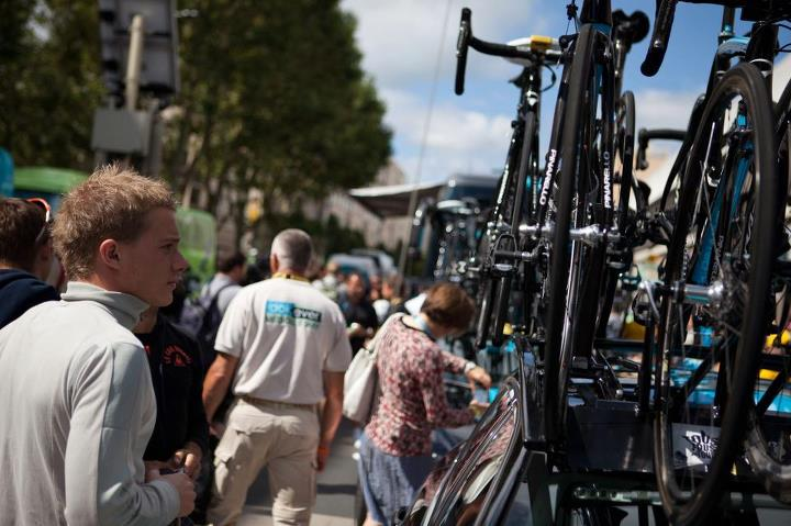 A fan admires the Sky Pro Cycling team bikes