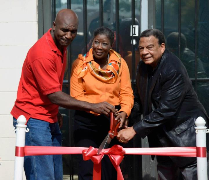 Entertainment Evander Holyfield, Caring for Others Founder Eslene Richmond-Shockley, and former U.N. Ambassador Andrew Young cut the ribbon for the new Caring for Others community center.