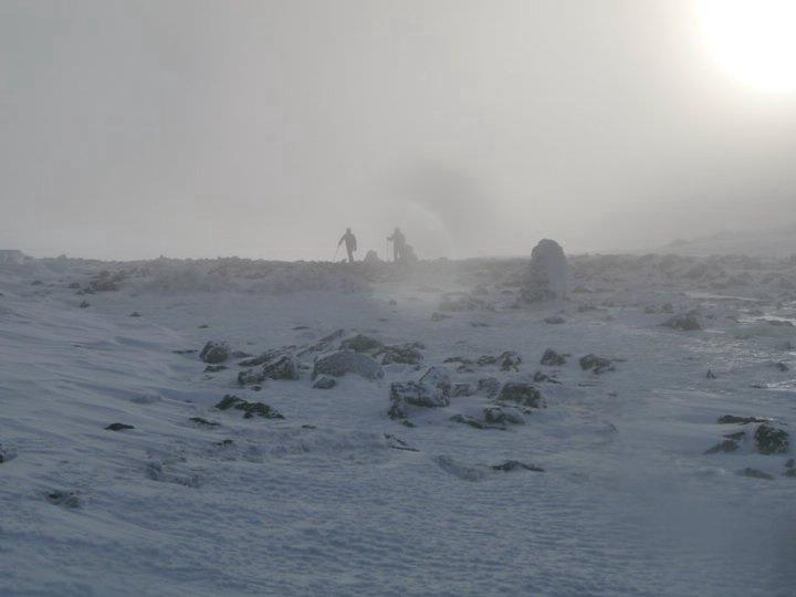 Camp and Hike On top of mount washington. 70mph winds that's Matthew McClellan and Austin Brochetti in the distance.