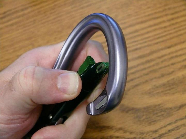 Climbing The magnets in the arms that lock the carabiner closed are just visible in this picture. Notice the I-Beam construction the taper that results in more material in the part of the carabiner body that will get the most wear when belaying/rapelling.