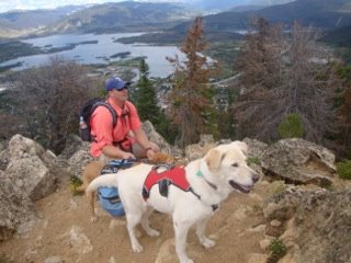 Camp and Hike This is a picture of our 10 year-old lab, Abby, at the summit of the Mt. Royal trail in Frisco, Colorado. She is enjoying the panoramic views of the Dillon Reservoir, Ten Mile Canyon, and Buffalo Mountain from an elevation of 10,494 feet. Abby wears the R