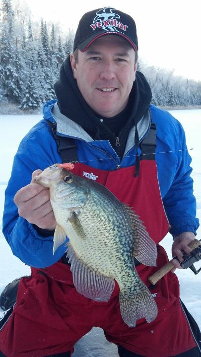 Fishing Vexilar Pro, Corey Studer, hoists a nice crappie caught in Northern MN caught on a Salmo Chubby Darter!