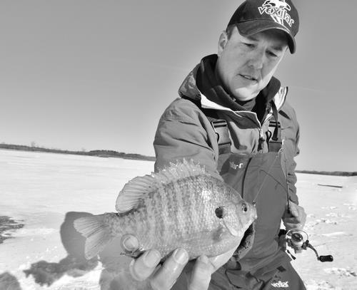 Fishing Corey Studer with a nice Northern MN sunfish!