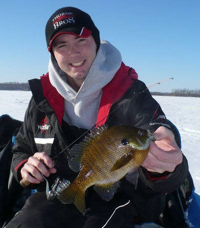 Fishing Vexilar Pro Staffer, Corey Bechtold, with a GIANT sunfish!