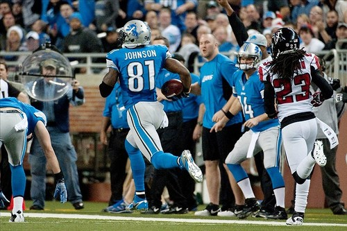 Sports  Calvin Johnson sets NFL record for most receiving yards in a season, passing Jerry Rice's 1848 yds in 1995.
