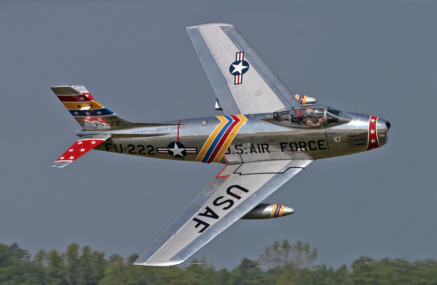 Guns and Military Wyatt Fuller flying his restored F-86E Sabre. Tragically, this plane and pilot were lost in a crash on 24 July 2006