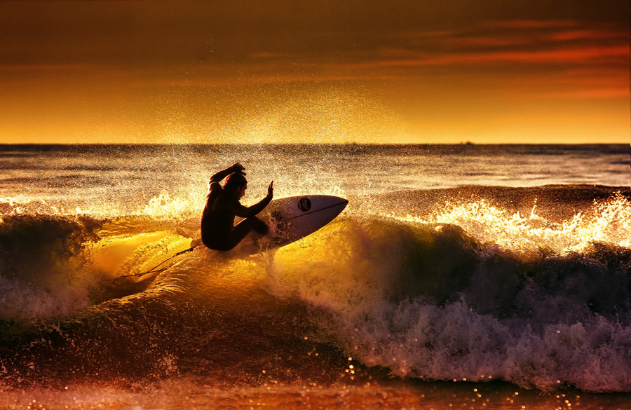 Surf last ride at sunset