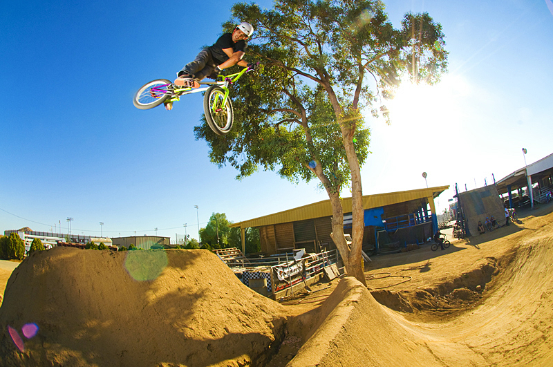BMX Ricardo Laguna, 360 X-up over last set of the dirt jumps at the Compound skatepark in Perris, California.