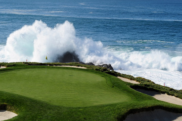 Golf The waves come crashing into the famous par-3 seventh green at Pebble Beach