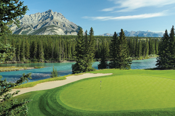Golf Banff Springs Golf Course winds along the Bow River in Canada's Rocky Mountains
