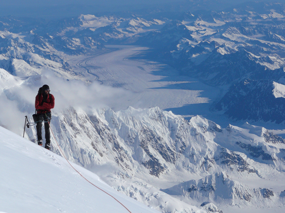 Climbing A mountaineer taking in the scenery of Denali National Park