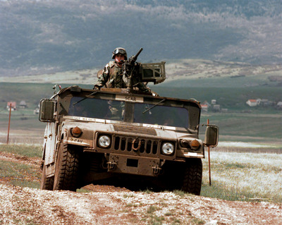 Guns and Military A U.S. Army scout team maneuvers their Humvee