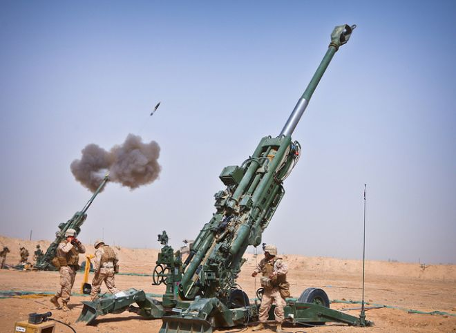 Guns and Military Sept. 29, 2011: Marines with Charlie Battery, 1st Battalion, 12th Marine Regiment, fire an M982 Excalibur round from an M777 howitzer