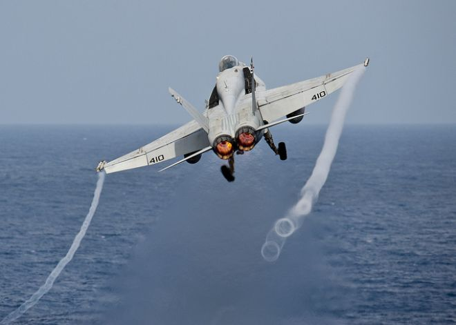 Guns and Military Jan. 31, 2012: An F/A-18C Hornet launches from the Nimitz-class aircraft carrier, the USS John C. Stennis.