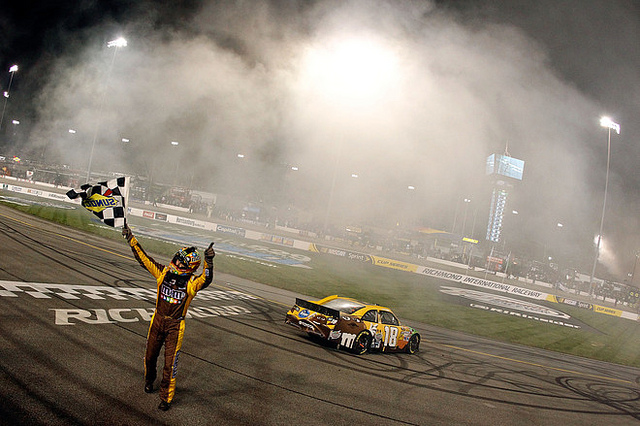Motorsports yle Busch, driver of the #18 M&M's Ms. Brown Toyota, celebrates with the checkered flag after winning the NASCAR Sprint Cup Series Capital City 400 at Richmond International Raceway on April 28, 2012
