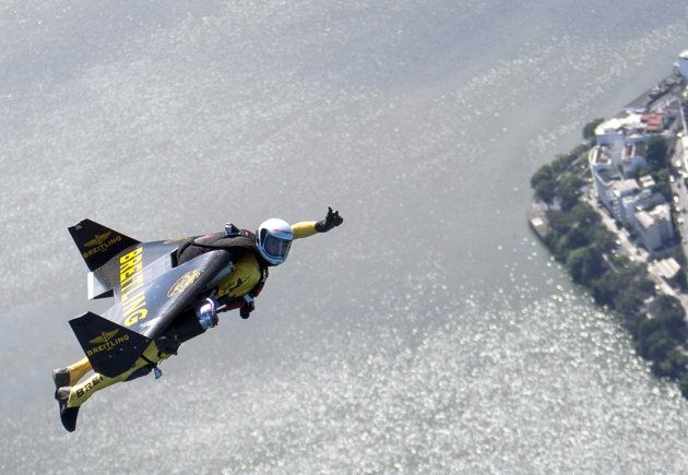 Extreme Yves Rossy, known as the Jetman, flies over Rio de Janiero during a successful flight
