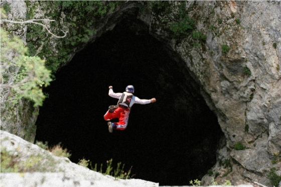 Extreme Felix Baumgartner plunging into the deep black hole of the Mamet Cave