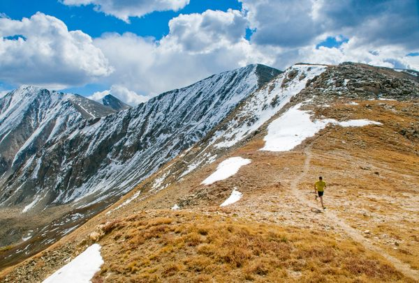 Fitness A trail runner traces an alpine ridge on the Continental Divide Trail.