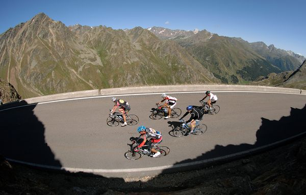 Road bikers pedal the Austria's Ötztal Glacier Road,