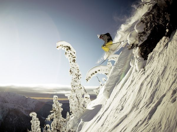 Ski Lynsey Dyer drops through the backcountry near Mustang Powder Lodge, British Columbia.