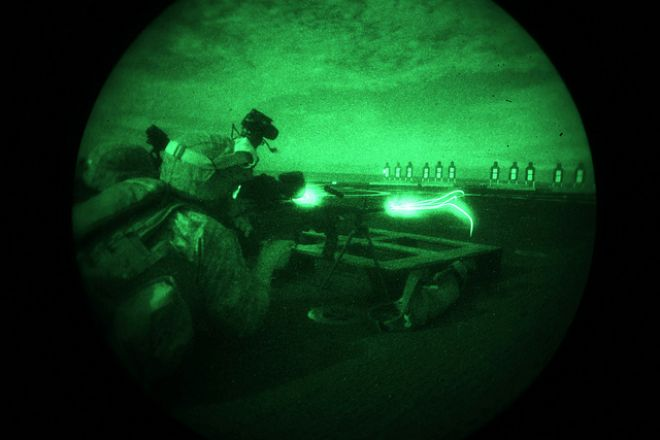 Guns and Military April 5, 2012: Cpl. Richard Hardeman fires an M-249 during a nighttime round of live-fire.