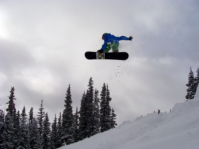 Snowboard Fun on a Kicker up at Berthoud Pass, CO.
