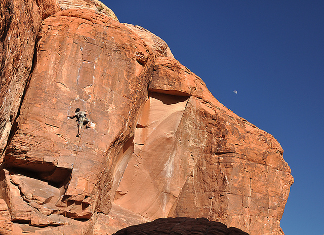 Climbing Red Rock Climber and Moon