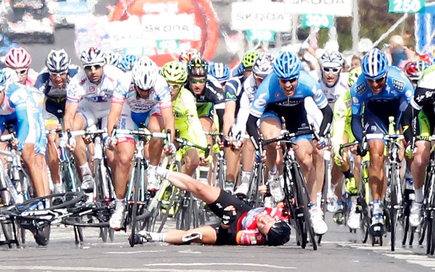 Team Sky rider Mark Cavendish of Britain crashes during the final rush of the 190km third stage of the Giro d'Italia in Horsens, Denmark