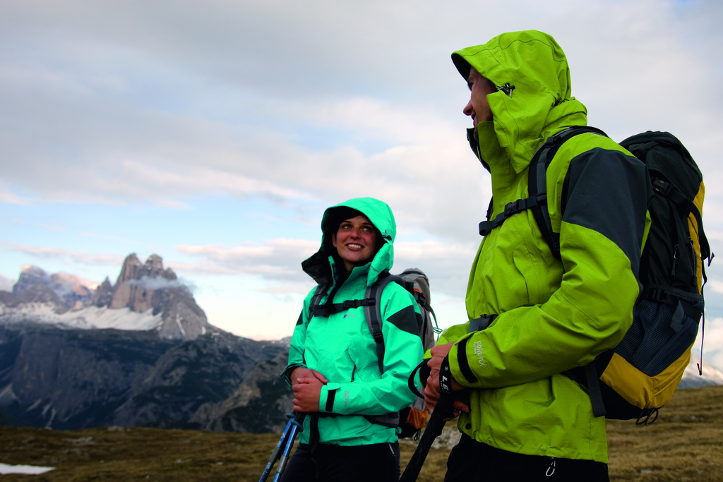 Camp and Hike Couple hiking in the rain, Italian Dolomites