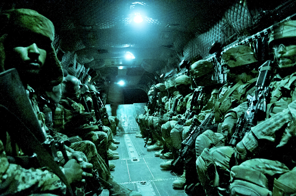 Guns and Military Paratroopers with the 82nd Airborne Division's 1st Brigade Combat Team and Afghan National Army soldiers with 6th Kandak, 203rd Corps, travel aboard a CH-47 Chinook heavy lift helicopter during an air assault mission May 4, 2012,