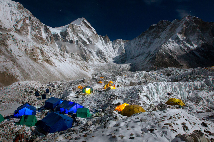 Extreme Everest Base Camp and the Khumbu Glacier glow beneath a full moon.