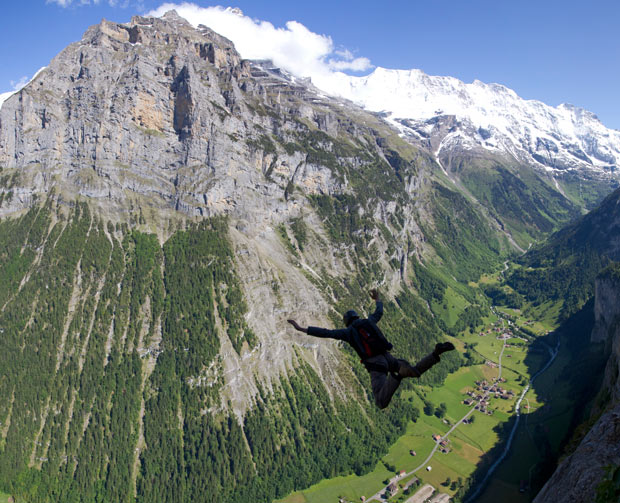 "Extreme Simo Moilanen is silhouetted while leaving ""The Ultimate"" exit point above Lauterbrunnen / Stechelberg"