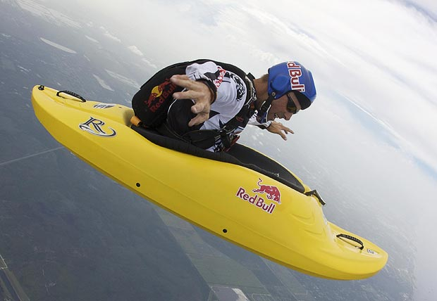 Extreme Danger man Miles Daisher casts a bizarre image paddling across the sky - 13,000 feet up in a kayak