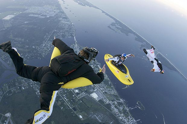 Extreme danger man Miles Daisher skydives in a kayak