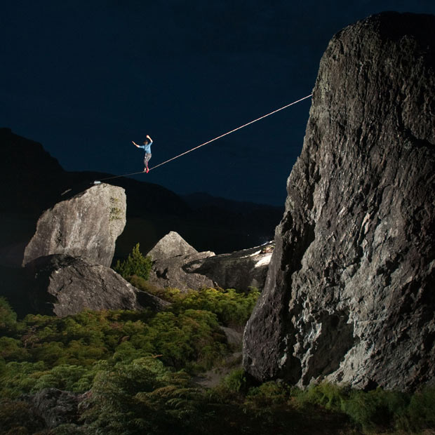 Extreme James Clulow walks along a slackline strung between two boulders in Wanaka, New Zealand