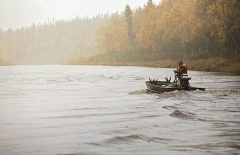 On a johnboat on a tributary of the Yukon River in southwest Alaska, hauling out a bull moose with a 58-inch rack last September.