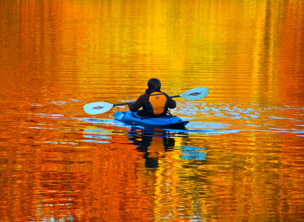 Kayak and Canoe Floating in fire