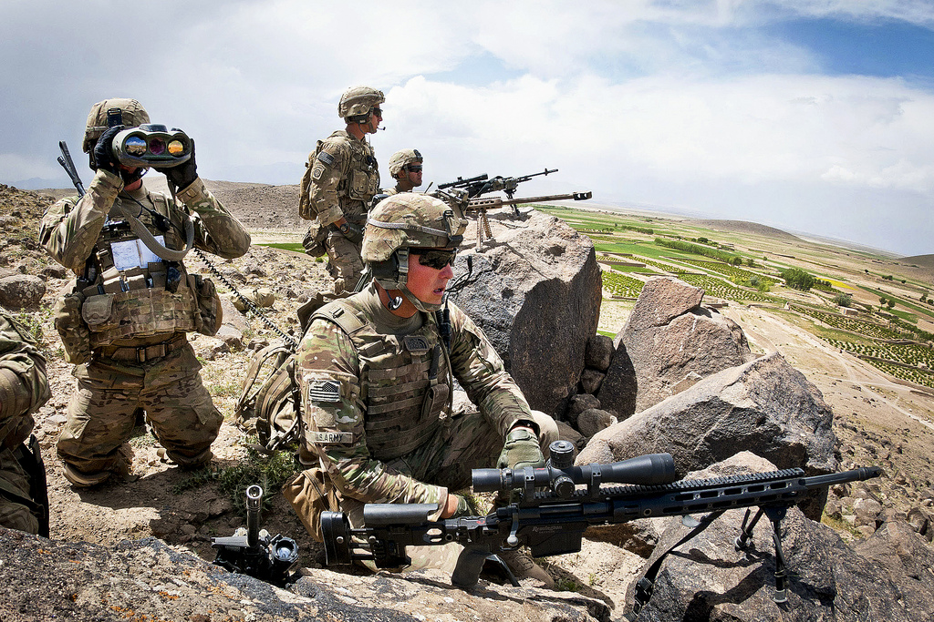 Guns and Military Snipers with the 82nd Airborne Division's 1st Brigade Combat Team provide overwatch for fellow paratroopers in a village below them May 19, 2012, Ghazni Province, Afghanistan.