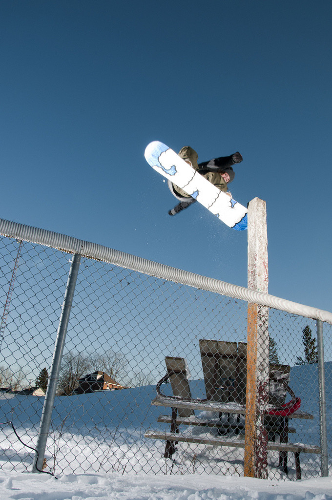 Snowboard Adam Carmichael - Tail tap to fakie over the fence