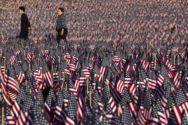 Guns and Military Relatives and volunteers planted 33,000 flags in tribute to Massachusetts soldiers killed in conflicts
