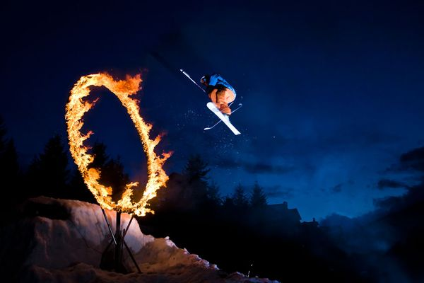 Ski A crazy skier in Whistler, Canada, jumping through a ring of fire.