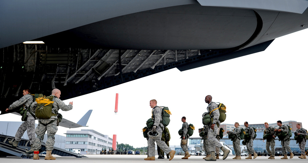 Guns and Military U.S. Air Force Airmen and U.S. Army Soldiers board a C-17 Globemaster III at Ramstein Air Base,