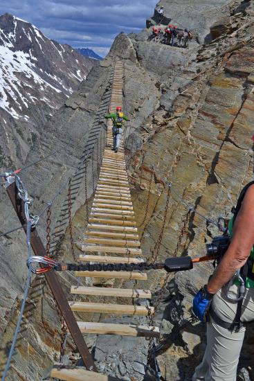 Camp and Hike The long suspension bridge midway on the via ferrata in the Bugaboos requires focus when it starts swaying
