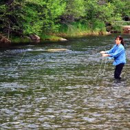 Flyfishing A fly fisherman tries her luck in the Boulder River on the Hawley Mountain Ranch