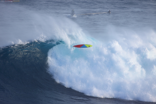 Surf Surfers paddled into waves that sometimes had 35-foot faces at Jaws in Peahi
